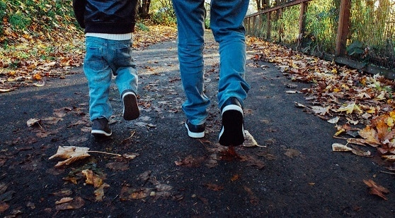 Father and son walking on path